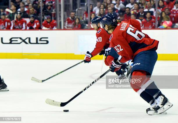 Washington Capitals left wing Carl Hagelin brings the puck up ice in the first period against the Winnipeg Jets on March 10 at the Capital One Arena...