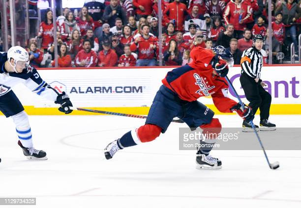 Washington Capitals left wing Carl Hagelin scores a second period goal against Winnipeg Jets defenseman Tyler Myers on March 10 at the Capital One...