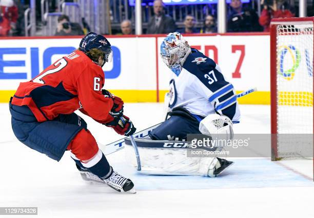 Washington Capitals left wing Carl Hagelin scores a second period goal against Winnipeg Jets goaltender Connor Hellebuyck on March 10 at the Capital...