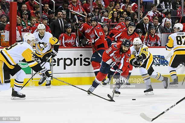 Washington Capitals left wing Daniel Winnik fights for control of the puck in the first period against Pittsburgh Penguins left wing Conor Sheary on...