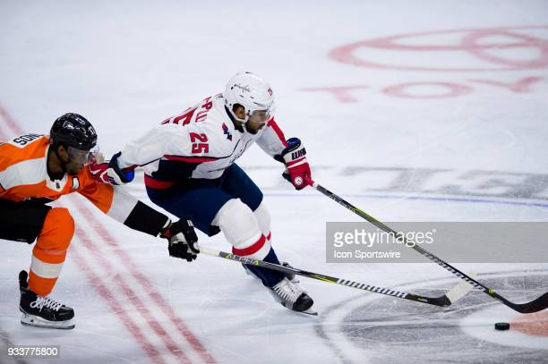 Washington Capitals Left Wing Devante SmithPelly keeps the puck from Philadelphia Flyers Right Wing Wayne Simmonds in the third period during the...