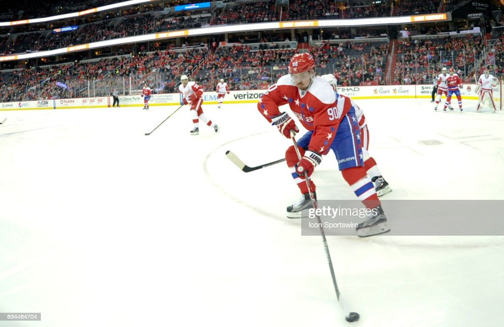 00ce319d542 Washington Capitals left wing Marcus Johansson (90) skates against the  Detroit Red Wings on