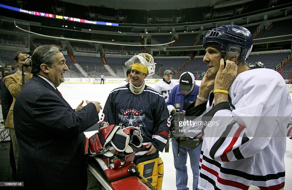 Washington Capitals owner Ted Leonsis, U.S. Rep. Anthony Weiner (D-NY) and Sen. John Kerry (D-MA) attend the Congressional Hockey Challenge charity game to benefit Fort Dupont Ice Hockey Club at the Verizon Center on March 10, 2011 in Washington, DC.