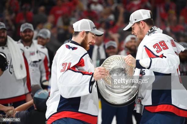 Washington Capitals Right Wing Alex Chiasson hands the Stanley Cup to Washington Capitals Goalie Philipp Grubauer after defeating the Las Vegas...