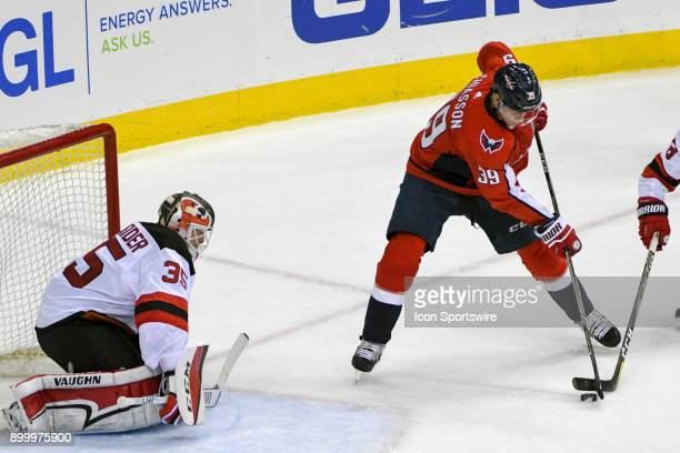 Washington Capitals right wing Alex Chiasson shoots on New Jersey Devils goaltender Cory Schneider in the third period on December 30 at the Capital...
