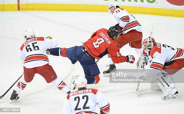 Washington Capitals right wing Alex Ovechkin tumbles after shooting a shot on goal during first period action against the Carolina Hurricanes on...
