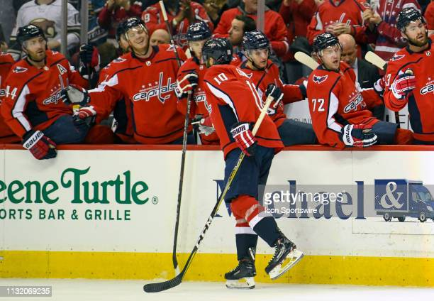 Washington Capitals right wing Brett Connolly is congratulated by the bench after scoring the second period against the Minnesota Wild March 22 at...