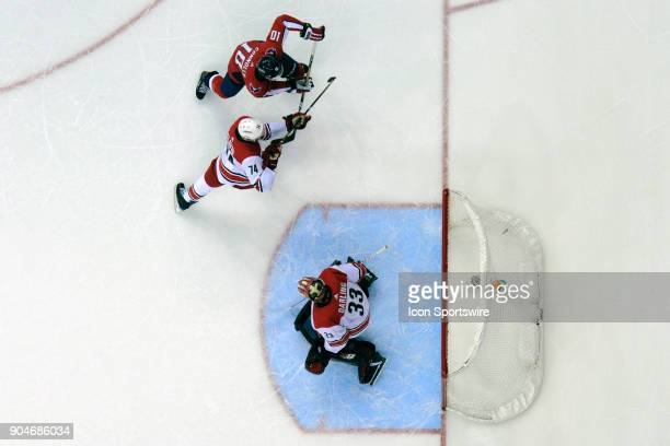 Washington Capitals right wing Brett Connolly scores against Carolina Hurricanes goaltender Scott Darling on January 11 at the Capital One Arena in...