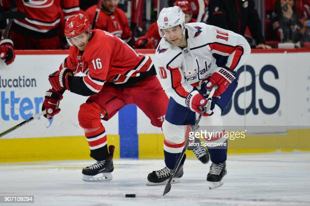 Washington Capitals Right Wing Brett Connolly skates away from Carolina Hurricanes Center Marcus Kruger during a game between the Washington Capitals...