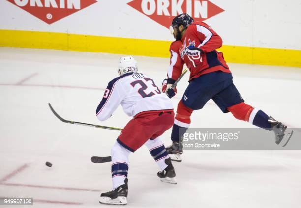 Washington Capitals right wing Devante SmithPelly shoots past Columbus Blue Jackets defenseman Ian Cole during the first round Stanley Cup playoff...