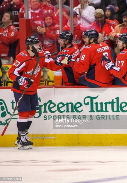 Washington Capitals right wing Dmitrij Jaskin is congratulated by left wing Alex Ovechkin after a goal against the Detroit Red Wings on December 11...
