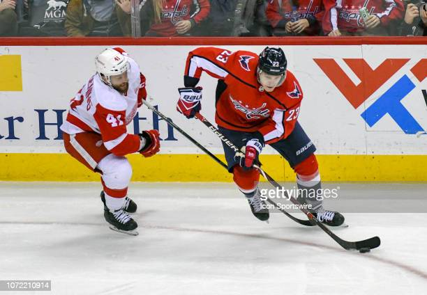 Washington Capitals right wing Dmitrij Jaskin skate against Detroit Red Wings center Luke Glendening in the third period on December 11 at the...
