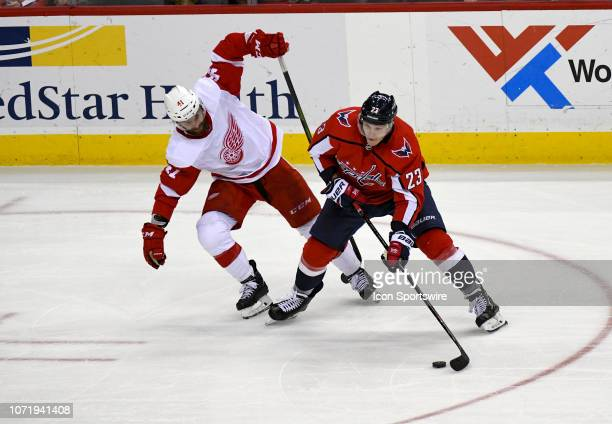 Washington Capitals right wing Dmitrij Jaskin skates in the third period against Detroit Red Wings center Dylan Larkin on December 11 at the Capital...