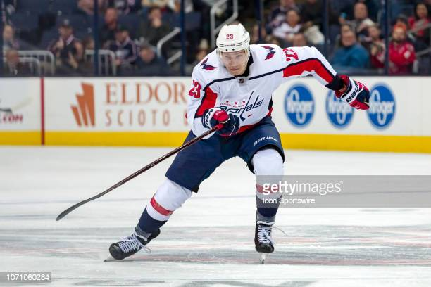 Washington Capitals right wing Dmitrij Jaskin sprints towards the puck in a game between the Columbus Blue Jackets and the Washington Capitals on...