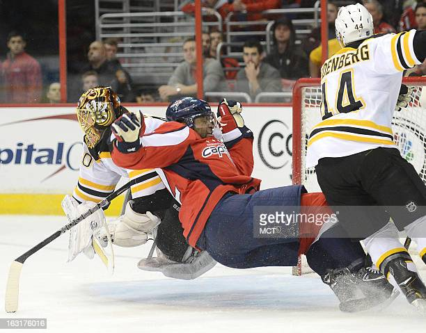 Washington Capitals right wing Joel Ward and Boston Bruins goalie Tuukka Rask left fall to the ice hard after Rask made a save in the second period...