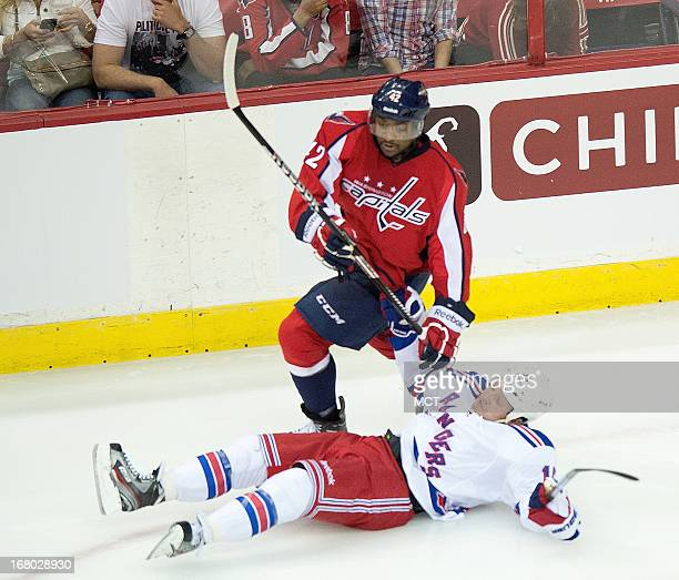 Washington Capitals right wing Joel Ward stands over New York Rangers forward Derek Dorsett after taking him down tot he ice in the second period of...