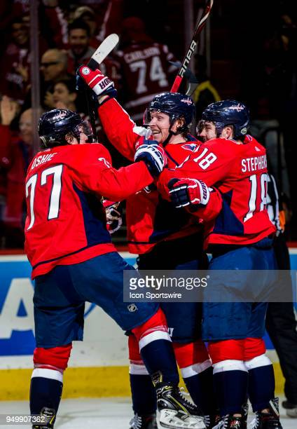 Washington Capitals right wing TJ Oshie and center Chandler Stephenson surround center Nicklas Backstrom after his game winning goal during the first...