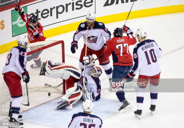 Washington Capitals right wing TJ Oshie celebrates the Capitals first goal by center Nicklas Backstrom in the first period during the first round...