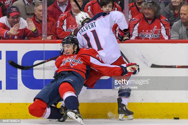 Washington Capitals right wing TJ Oshie collides with Columbus Blue Jackets left wing Matt Calvert in the first period on April 21 at the Capital One...
