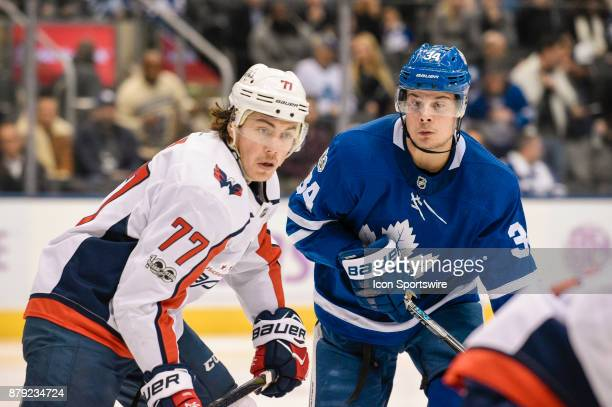 Washington Capitals Right Wing TJ Oshie fight for the puck with Toronto Maple Leafs Center Auston Matthews during the NHL regular season hockey game...