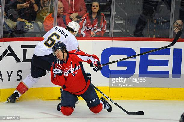 Washington Capitals right wing TJ Oshie goes to the ice after being hit under the face mask by Florida Panthers defenseman Alex Petrovic in the third...
