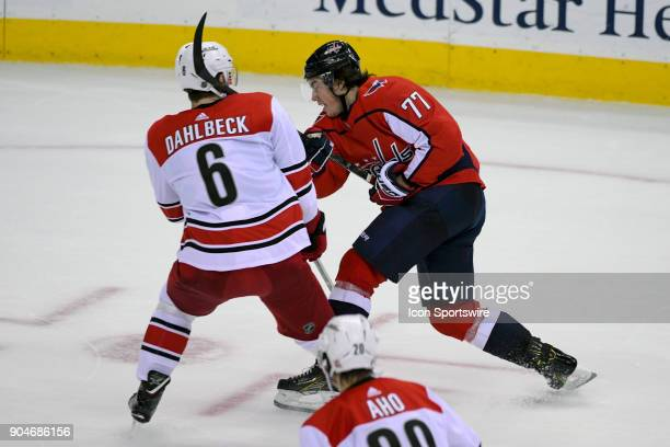 Washington Capitals right wing TJ Oshie has his stick hit Carolina Hurricanes defenseman Klas Dahlbeck on January 11 at the Capital One Arena in...