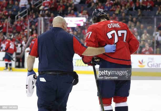 Washington Capitals right wing TJ Oshie helped off the ice in the second period he did not return for the third period during a NHL game between the...