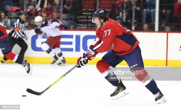 Washington Capitals right wing TJ Oshie moves the puck up ice in the first period during a NHL game between the Washington Capitals and the Columbus...