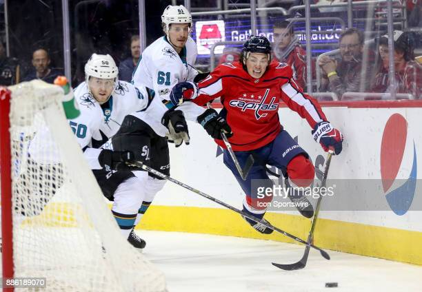 Washington Capitals right wing TJ Oshie skates leave the ice as he is pursued by San Jose Sharks center Chris Tierney and defenseman Justin Braun...