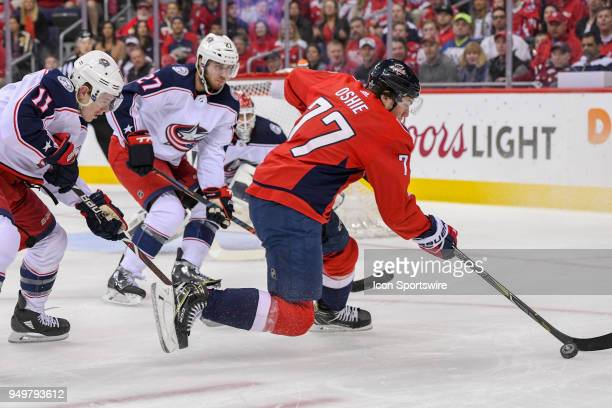 Washington Capitals right wing TJ Oshie takes a first period shot against Columbus Blue Jackets defenseman Ryan Murray and left wing Matt Calvert on...