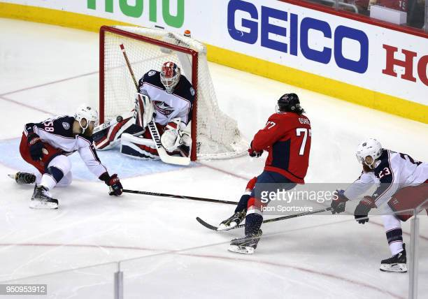 Washington Capitals right wing TJ Oshie takes a shot on goal during a match between the Washington Capitals and the Columbus Blue Jackets on April 12...