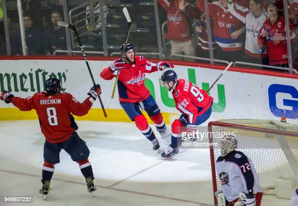 Washington Capitals right wing Tom Wilson and left wing Alex Ovechkin celebrate the second goal by center Evgeny Kuznetsov in the second period...