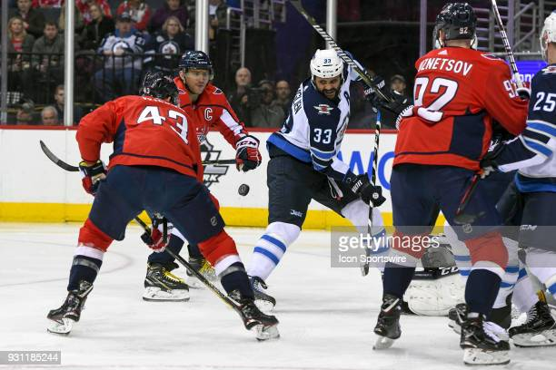 Washington Capitals right wing Tom Wilson assists left wing Alex Ovechkin on his second period NHL 600th goal against Winnipeg Jets defenseman Dustin...