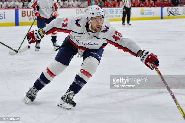Washington Capitals Right Wing Tom Wilson attempts to control a loose puck during a game between the Washington Capitals and the Carolina Hurricanes...