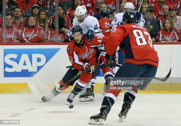 Washington Capitals right wing Tom Wilson fights for puck control with Toronto Maple Leafs center Nazem Kadri in the third period on April 15 at the...