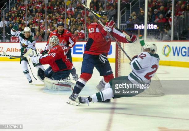 Washington Capitals right wing Tom Wilson hits Minnesota Wild left wing Kevin Fiala in the first period on March 22 at the Capital One Arena in...