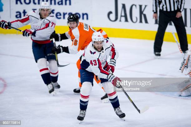 Washington Capitals Right Wing Tom Wilson reaches out to make a deflection in the third period during the game between the Washington Capitals and...