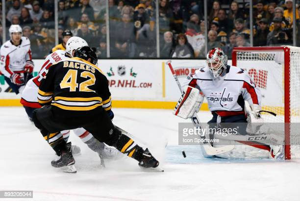 Washington Capitals right wing Tom Wilson ties up Boston Bruins center David Backes in front of Washington Capitals goalie Braden Holtby during a...
