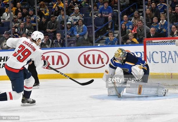 Washington Capitals rightwing Alex Chiasson shoots and scores against St Louis Blues goalie Jake Allen during a NHL game between the Washington...