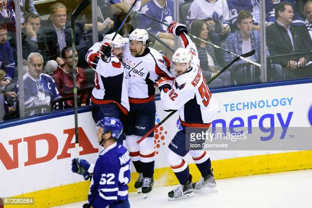 Washington Capitals Winger Marcus Johansson celebrates after scoring the game winning goal with Center Evgeny Kuznetsov and Right Wing Justin...