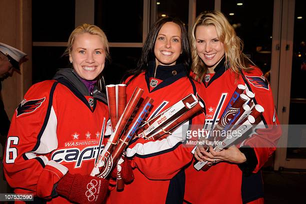 Washington Capitals' wives Rachel Fehr Kim Hendricks and Rachel Erskine help out during Toys for Tots drive before a NHL hockey game against the...