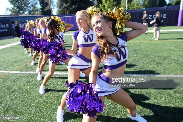 Washington cheerleaders pumped up the fans in the fan zone before the game. Washington defeated Eastern Washington in Seattle Washington.
