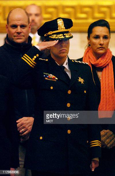 Washington Chief of Police Cathy L Lanier salutes during the changing of the Honor Guard on duty at the casket of President Gerald R Ford in the...