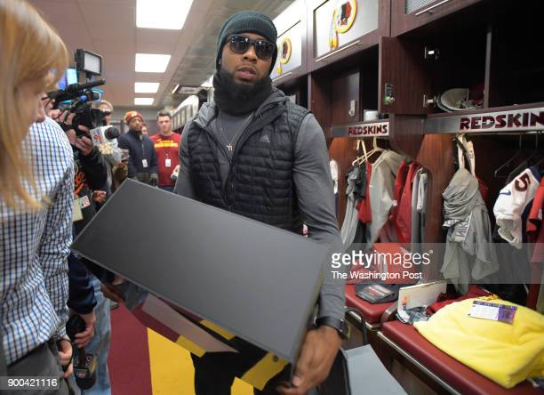 Washington conner back Josh Norman hauls off a box from his locker as he and other Washington Redskins teammates clean out their lockers at Redskins...