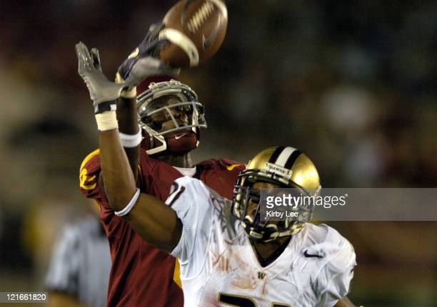 Washington cornerback Derrick Johnson breaks up a pass intended for USC freshman receiver Dwayne Jarrett in the fourth quarter of 380 loss in...