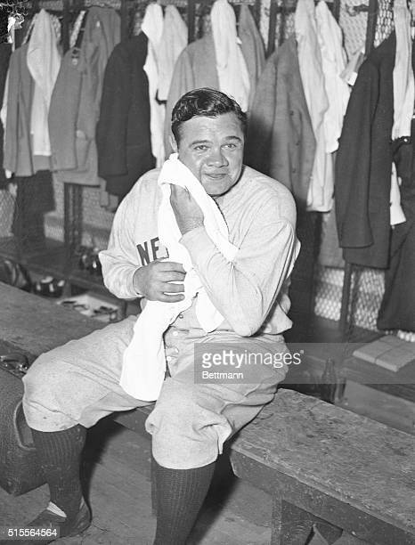 A few minutes after Babe Ruth retired form the game Sunday he is shown in the clubhouse wiping off the perspiration after a hectic day trying to hit...
