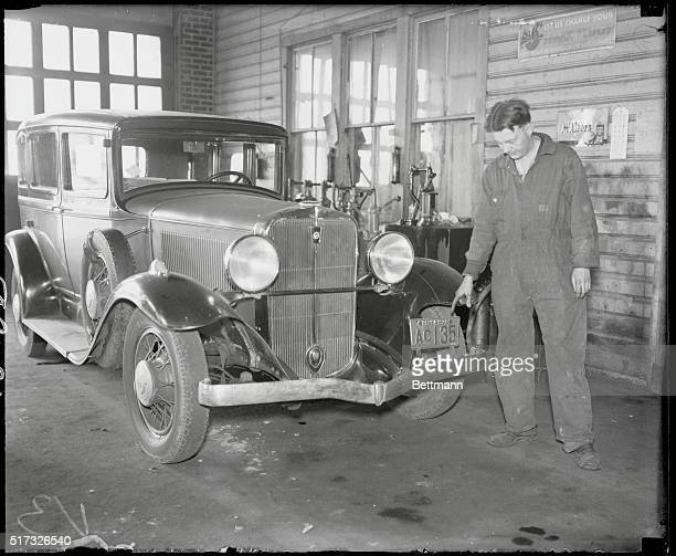 CIS This The Lindbergh Kidnap Auto Harry Cole Service Station operator examining the car left at his place in Hyattsville near Washington by a man...