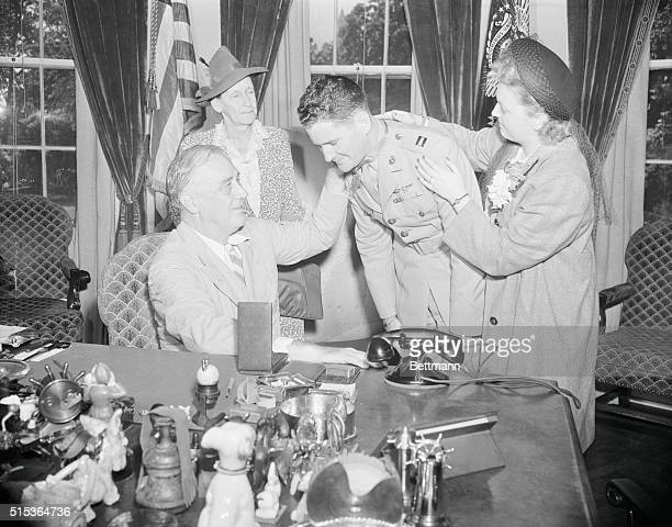 Washington, D. C.: Foss-Roosevelt. Foss Honored By Roosevelt. Captain Joseph J. Foss, U. S. Marine receives the Congressional Medal of Honor from...