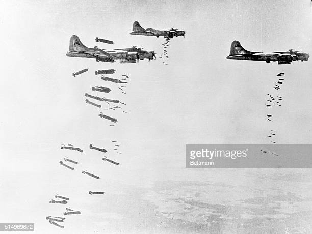 'Hell's Angeles' Pour It On From Heaven A striking photo made from an accompanying plane showing Flying Fortresses of the 303rd bomber group dropping...