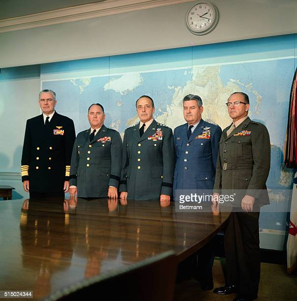 Members of the Joint Chiefs of Staff and Gen D M Shoup Commandant of the U S Marine Corps pose for photographers in their conference room at the...